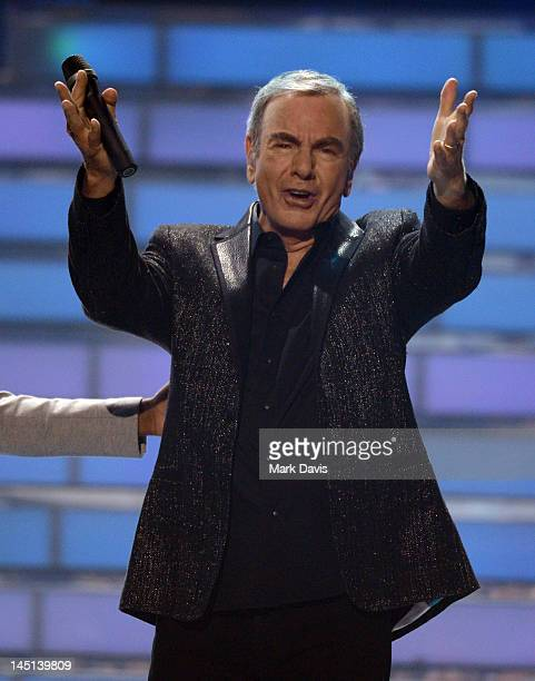 Singer Neil Diamond performs onstage during Fox's American Idol 2012 results show at Nokia Theatre LA Live on May 23 2012 in Los Angeles California