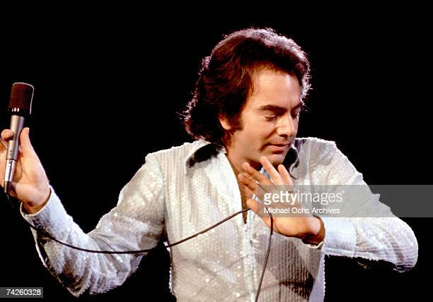 Singer Neil Diamond performs onstage wearing a sequin shirt in circa 1977 in Los Angeles California