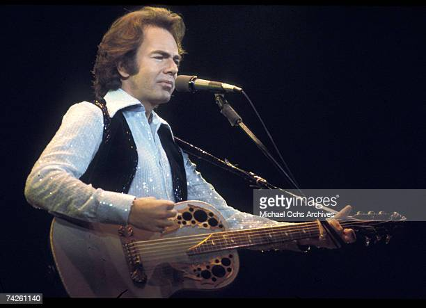 Singer Neil Diamond performs onstage with an Ovation acoustic guitar in circa 1977 in Los Angeles California