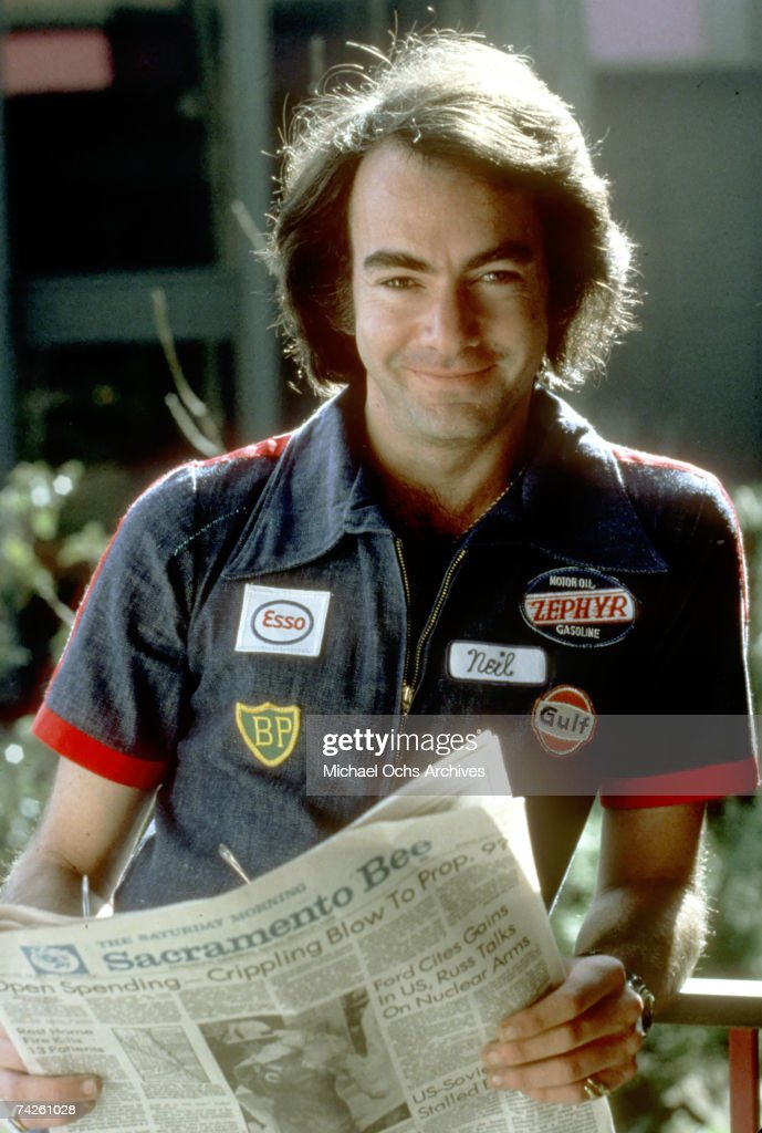 Singer Neil Diamond poses for a portrait session in a blue jumpsuit in May 1984 in Los Angeles, California.