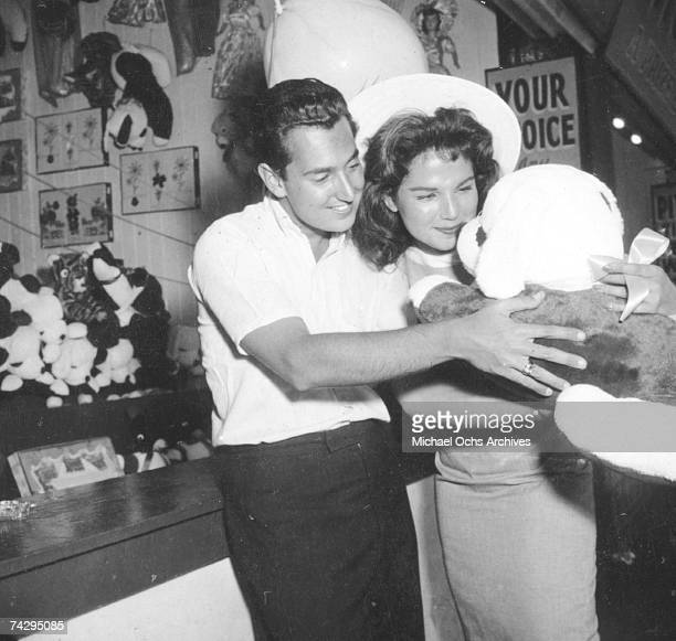 Singer Neil Sedaka and his then girlfriend Leba Strassberg whom he would later marry spend a romantic day going to Coney Island playing music going...