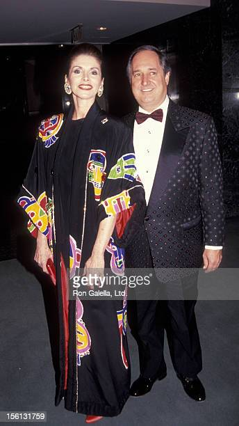 Singer Neil Sedaka and wife Leba Strassberg attending 'AmFAR Masquerade Benefit Gala' on December 5 1991 at the Winter Garden Theater in New York...