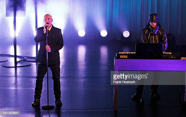 Singer Neil Tennant and Chris Lowe of Pet Shop Boys perform live during a concert at the Hebbel am Ufer on September 5 2012 in Berlin Germany