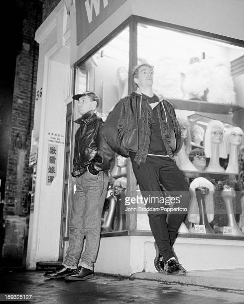 Singer Neil Tennant and keyboard player Chris Lowe of English electronic dance music duo the Pet Shop Boys outside a wig shop in Soho London in 1985
