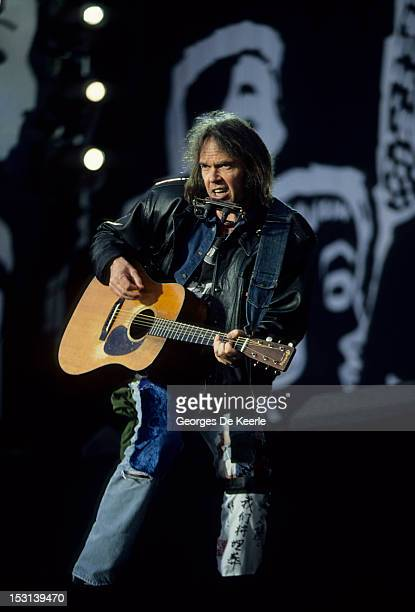 Singer Neil Young performs at a concert held to celebrate the release of African National Congress leader Nelson Mandela from prison Wembley Stadium...