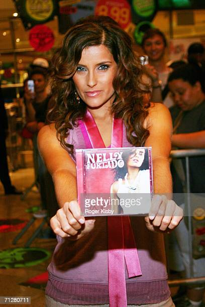 """Singer Nelly Furtado poses at a signing for her latest CD """"Loose"""" at Virgin Megastore Times Square on June 22, 2006 in New York City."""