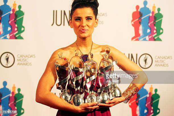 Singer Nelly Furtado poses backstage at the 2007 Juno Awards after winning five awards including Album of the Year at the Credit Union Centre on...