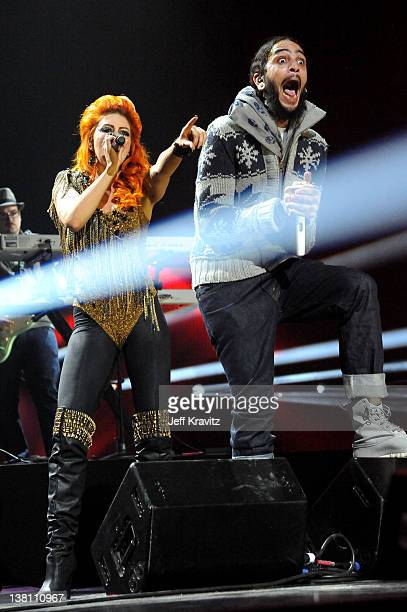 Singer Neon Hitch and Singer Travie McCoy of Gym Class Heroes perform onstage during VH1's Super Bowl Fan Jam at Indiana State Fairgrounds Pepsi...
