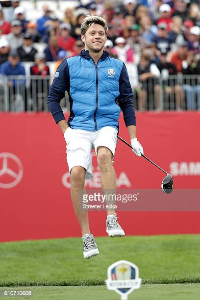 Singer Niall Horan of Europe prepares to hit off the first tee during the 2016 Ryder Cup Celebrity Matches at Hazeltine National Golf Club on...