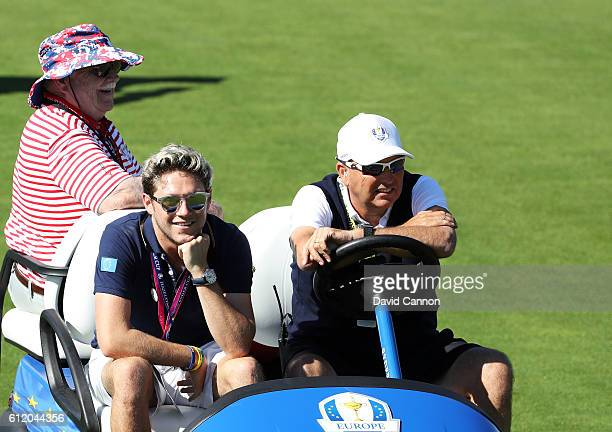 Singer Niall Horan of One Direction and actor Brian Doyle Murray look on during singles matches of the 2016 Ryder Cup at Hazeltine National Golf Club...