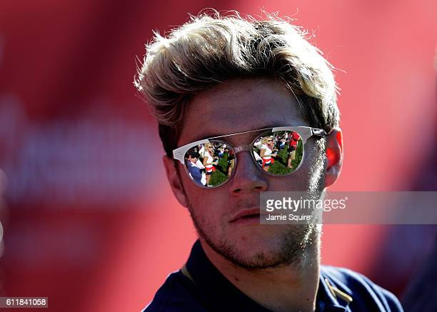 Singer Niall Horan of One Direction looks on from the 12th hole during afternoon fourball matches of the 2016 Ryder Cup at Hazeltine National Golf...