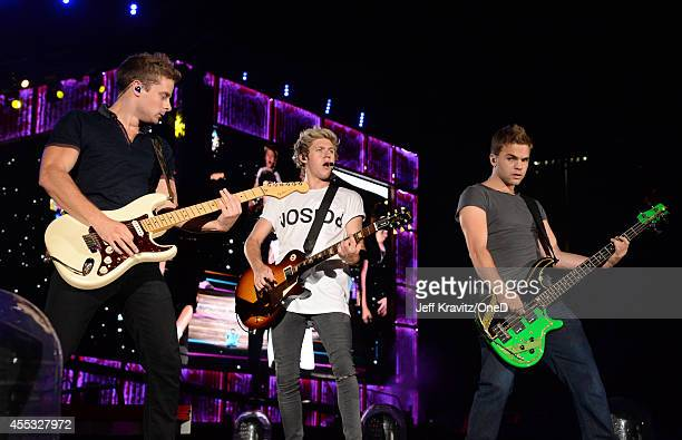 Singer Niall Horan of One Direction performs onstage during the One Direction Where We Are Tour at Rose Bowl on September 11 2014 in Pasadena...