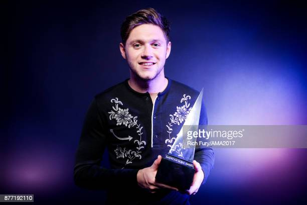 Singer Niall Horan poses for a portrait during the 2017 American Music Awards at Microsoft Theater November 19 2017 in Los Angeles California