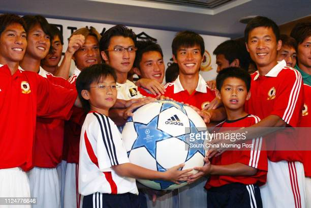 Singer Nicholas Tse Tingfung poses with the Hong Kong Football Team at a pledge ceremony ahead of their Manchester United game on July 23 2005 at...
