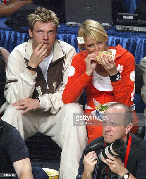Singer Nick Carter and girlfriend Paris Hilton attend the 2004 NBA AllStar Game held at the Staples Center February 15 2004 in Los Angeles California