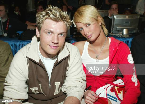 Singer Nick Carter and girlfriend Paris Hilton pose before the 2004 NBA AllStar Game held at the Staples Center February 15 2004 in Los Angeles...