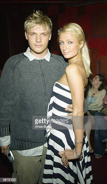 Singer Nick Carter and model Paris Hilton attend a party following Stuff Magazine's debut of The Bathroom Tapes at the production of Pieces on...