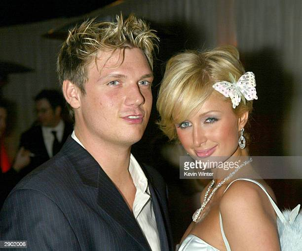 Singer Nick Carter and Paris Hilton arrive at the Miramax Golden Globes AfterParty at Trader Vics on January 25 2004 in Beverly Hills California