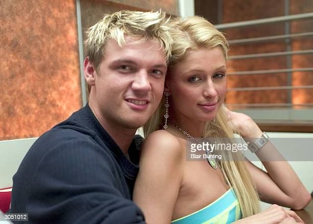 Singer Nick Carter and socialite Paris Hilton sit together during a benefit party at Steve Hanson's James Hotel on March 6 2004 in Scottsdale Arizona
