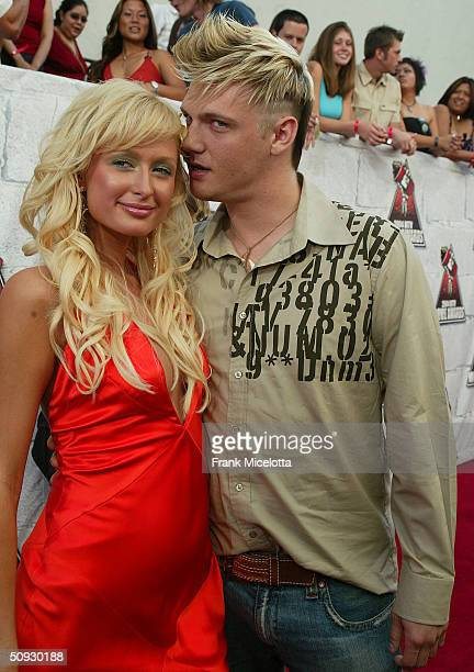 Singer Nick Carter and tv personality Paris Hilton arrive to the 2004 MTV Movie Awards at the Sony Pictures Studios on June 5 2004 in Culver City...