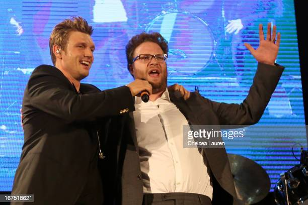 Singer Nick Carter of the Backstreet Boys and host Seth Rogen perform onstage during the Second Annual Hilarity For Charity benefiting The...