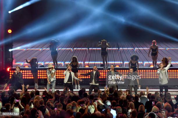 Singer Nick Carter of the Backstreet Boys recording artist Brian Kelley singers Brian Littrell AJ McLean Kevin Richardson and Howie Dorough of the...