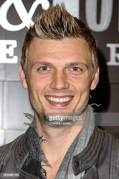 Singer Nick Carter of The Backstreet Boys signs copies of his new memoir 'Facing the Music' at Barnes Noble bookstore at The Grove on September 27...