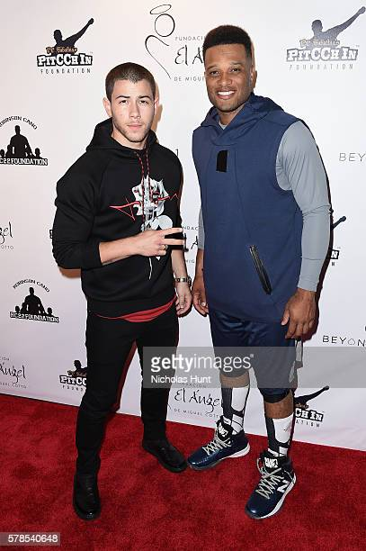 Singer Nick Jonas and baseball player Robinson Canó attend the Roc Nation Summer Classic Charity Basketball Tournament at Barclays Center of Brooklyn...
