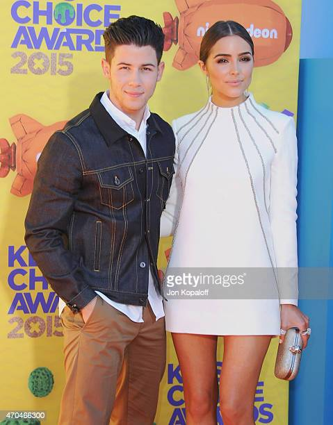 Singer Nick Jonas and Olivia Culpo arrive at Nickelodeon's 28th Annual Kids' Choice Awards at The Forum on March 28 2015 in Inglewood California