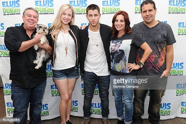Singer Nick Jonas and The Elvis Duran Morning Show's cast pose during 'The Elvis Duran Z100 Morning Show' at Z100 Studio on September 9 2014 in New...