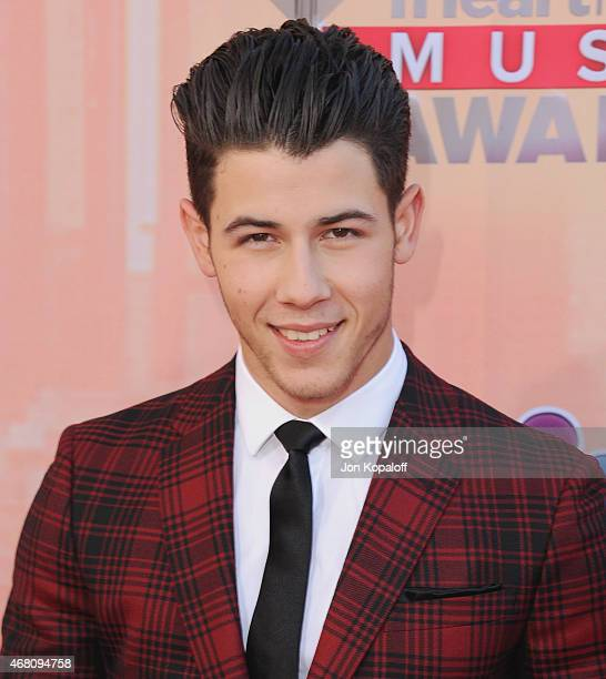 Singer Nick Jonas arrives at the 2015 iHeartRadio Music Awards at The Shrine Auditorium on March 29 2015 in Los Angeles California