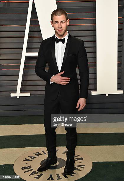 Singer Nick Jonas arrives at the 2016 Vanity Fair Oscar Party Hosted By Graydon Carter at Wallis Annenberg Center for the Performing Arts on February...