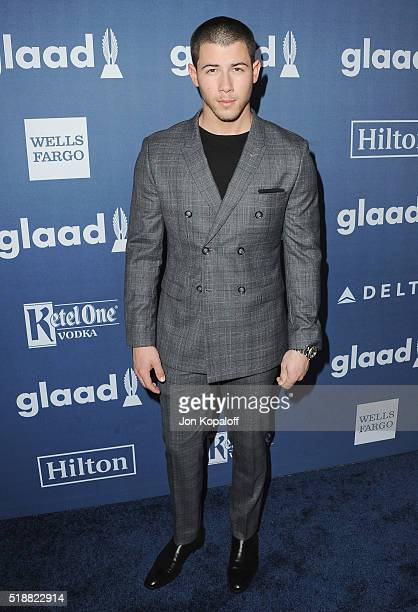 Singer Nick Jonas arrives at the 27th Annual GLAAD Media Awards at The Beverly Hilton Hotel on April 2 2016 in Beverly Hills California