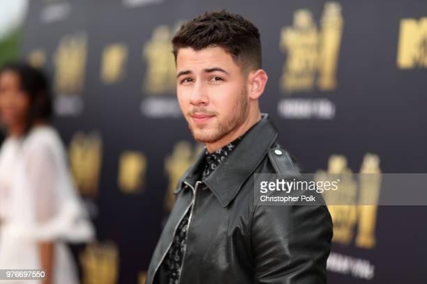 Singer Nick Jonas attends the 2018 MTV Movie And TV Awards at Barker Hangar on June 16 2018 in Santa Monica California