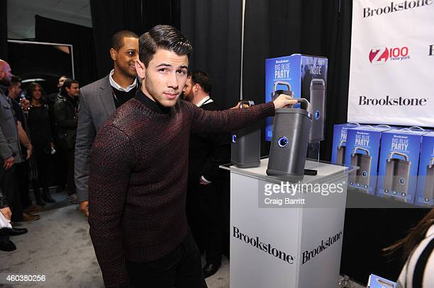 Singer Nick Jonas attends the Z100's Artist Gift Lounge presented by Goldfish Puffs at Z100's Jingle Ball 2014 at Madison Square Garden on December...
