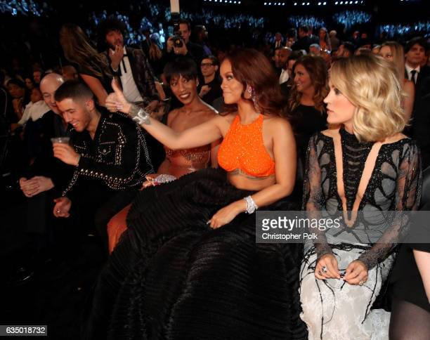 Singer Nick Jonas Melissa Forde and singers Rihanna and Carrie Underwood during The 59th GRAMMY Awards at STAPLES Center on February 12 2017 in Los...