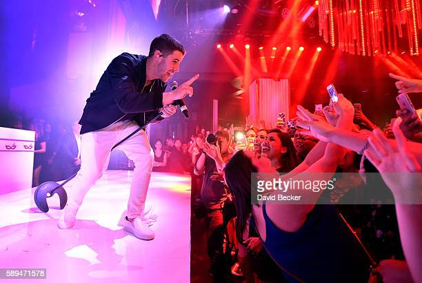 Singer Nick Jonas performs at Intrigue Nightclub at Wynn Las Vegas on August 13, 2016 in Las Vegas, Nevada.
