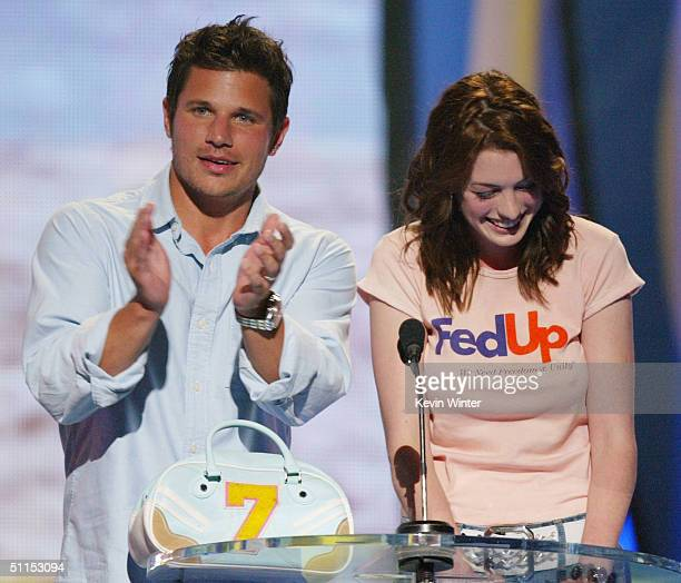 Singer Nick Lachey and actress Anne Hathaway speak on stage at The 2004 Teen Choice Awards held on August 8 2004 at Universal Amphitheater in...