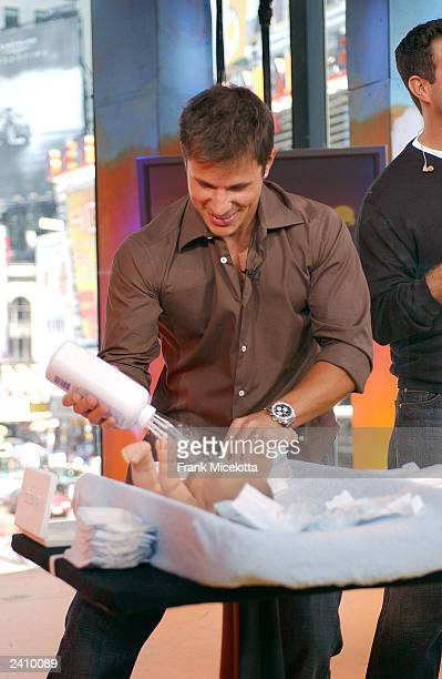 Singer Nick Lachey takes part in a babychanging contest against his wife Jessica Simpson on MTV TRL at the MTV Times Square Studios August 19 2003 in...