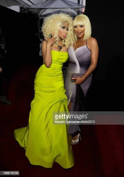 Singer Nicki Minaj and Christina Aguilera attend the 40th American Music Awards held at Nokia Theatre LA Live on November 18 2012 in Los Angeles...