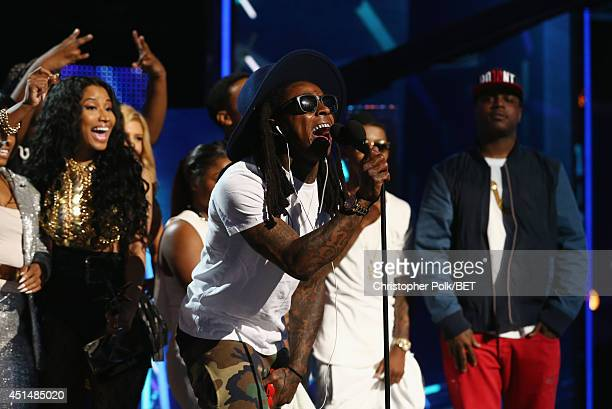 Singer Nicki Minaj and rapper Lil Wayne along with members of Young Money accept an award onstage during the BET AWARDS '14 at Nokia Theatre LA LIVE...
