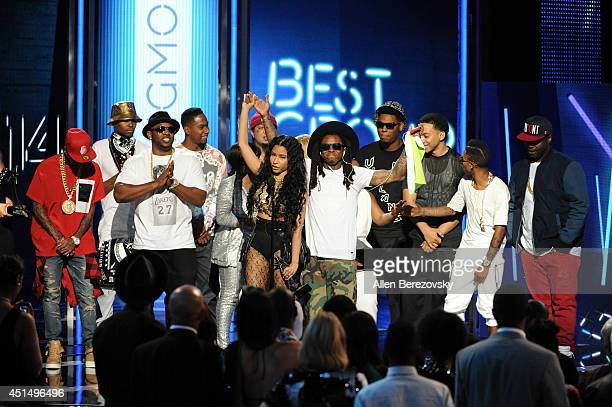 Singer Nicki Minaj and rapper Lil Wayne of Young Money accept Best Group award onstage during the BET Awards '14 at Nokia Theatre LA Live on June 29...