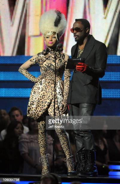Singer Nicki Minaj and singer william of the Black Eyed Peas speak onstage during The 53rd Annual GRAMMY Awards held at Staples Center on February 13...