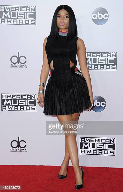 Singer Nicki Minaj arrives at the 2014 American Music Awards at Nokia Theatre LA Live on November 23 2014 in Los Angeles California