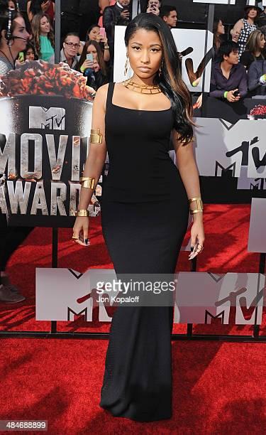 Singer Nicki Minaj arrives at the 2014 MTV Movie Awards at Nokia Theatre LA Live on April 13 2014 in Los Angeles California