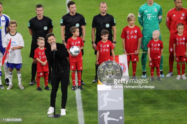 Singer Nico Santos performs prior to the Bundesliga match between FC Bayern München and Hertha BSC at Allianz Arena on August 16 2019 in Munich...