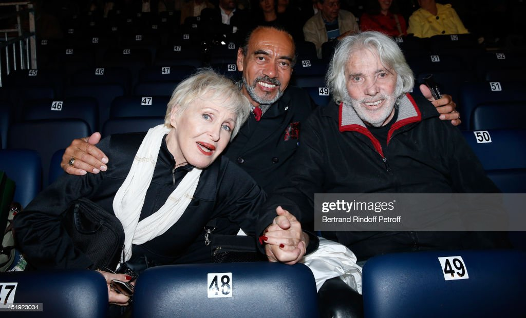 Singer Nicole Croisille, Larris Ekson and singer Pierre Barouh attend the 'Claude Lelouch en Musique ! Held at the Invalides in Paris on September 6, 2014 in Paris, France.