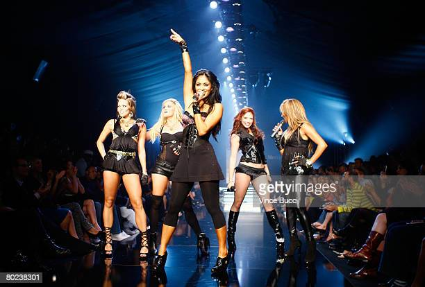 Singer Nicole Scherzinger and the Pussycat Dolls perform on the runway at the Pussycat Dolls by Robin Antin Fall 2008 fashion show during...