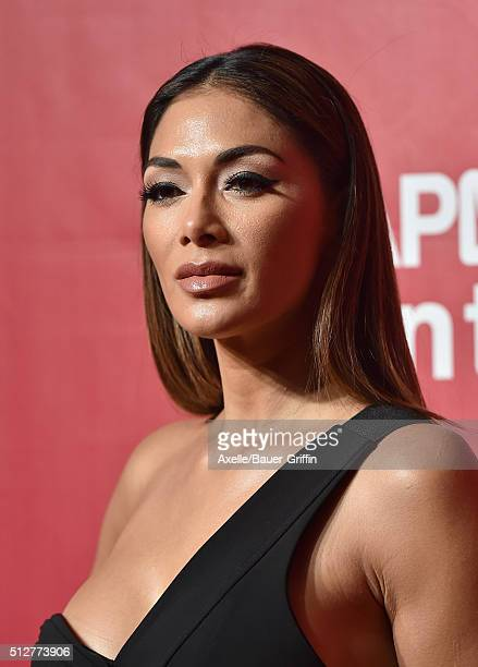 Singer Nicole Scherzinger arrives at the 2016 MusiCares Person of the Year honoring Lionel Richie at Los Angeles Convention Center on February 13...