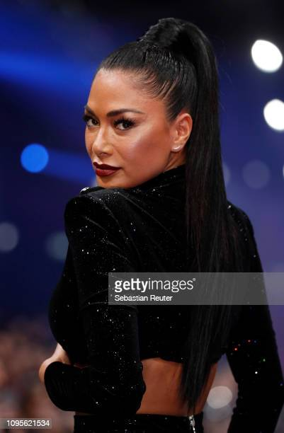 Singer Nicole Scherzinger performs on the runway at the Maybelline New York show 'Make-up that makes it in New York' during the Berlin Fashion Week...